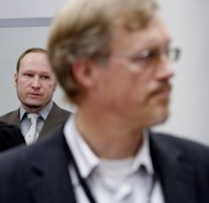 Norwegian right-wing extremist Anders Behring Breivik (left) looks on as social commentator Ole Joergen Anfindsen testifies on his right-wing ideology during the ongoing trial in Oslo. Norwegian right-wing extremists have ecried the &quot;Islamisation&quot; of their country as they took the stand in what Breivik&#39;s defence hopes will help prove he was sane when he killed 77 people in Norway last year