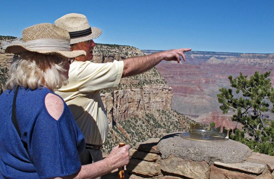Karen and Tom Jacobs, of Carrollton, Texas, look out over the South Rim of the Grand Canyon on Tuesday, Sept. 30, 2013. National parks would close Tuesday if an agreement is not reached on the federal budget. (AP Photo/Felicia Fonseca)