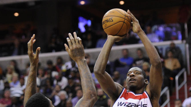Washington Wizards guard Jordan Crawford (15) takes a shot against Miami Heat forward Udonis Haslem (40) during the second half of an NBA basketball game, Tuesday, Dec. 4, 2012, in Washington. The Wizards won 105-101. (AP Photo/Nick Wass)