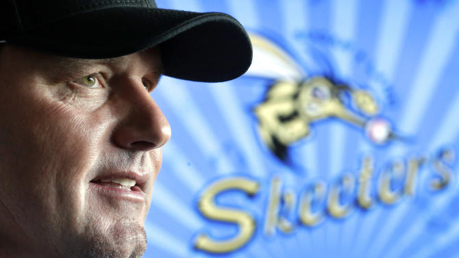 Roger Clemens talks with reporters after a news conference officially announcing his signing with the Sugar Land Skeeters baseball team, Tuesday, Aug. 21, 2012, in Sugar Land, Texas. Clemens, a seven-time Cy Young Award winner, signed with the Skeeters of the independent Atlantic League on Monday and is expected to start for the minor league team on Saturday at home against Bridgeport. (AP Photo/David J. Phillip)