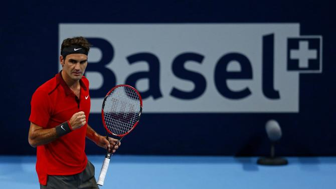 Roger Federer of Switzerland reacts during his match against Grigor Dimitrov of Bulgaria at the Swiss Indoors ATP tennis tournament in Basel