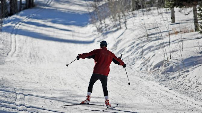 FILE - This Feb. 3, 2009 file photo shows a cross-country skier in Medicine Bow National Forest's Tie City in Albany County, Wyo. There are also plenty of free ways to experience the backcountry wilderness in every season, from warm-weather hikes in the vast Medicine Bow National Forest to snowshoeing and cross-country skiing followed by a soak in a hot spring as snow falls. (AP Photo/Laramie Boomerang, Andy Carpenean, File)
