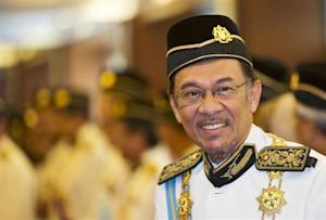 Malaysia's opposition leader Anwar Ibrahim smiles as he he arrives for the opening of the parliament sitting at Parliament House in Kuala Lumpur