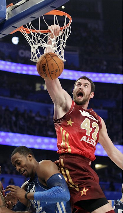 Western Conference's Kevin Love (42), of the Minnesota Timberwolves, dunks on Eastern Conference's Dwight Howard (12), of the Orlando Magic, during the first half of the NBA All-Star basketball game, 