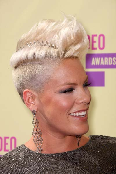 The latest and fiercest COVERGIRL P!nk added a crazy strip of studded spikes to her already-insane shaved platinum pompadour for a memorably outrageous look. (Frederick M. Brown/Getty)