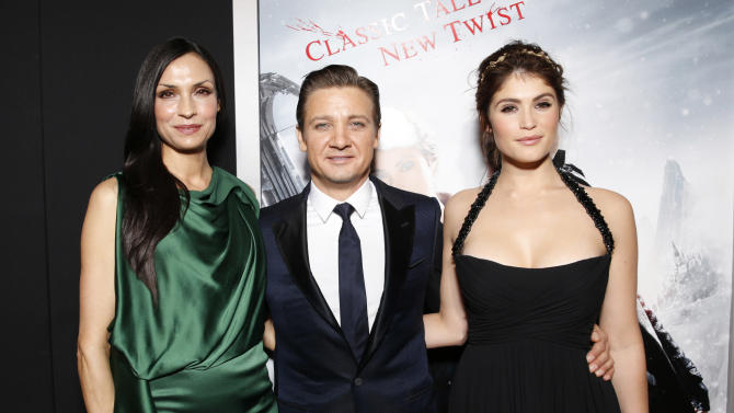 "Famke Janssen, Jeremy Renner and Gemma Arterton attend the premiere of ""Hansel & Gretel Witch Hunters"" on Thursday Jan. 24, 2013, in Los Angeles.  (Photo by Todd Williamson/Invision/AP)"