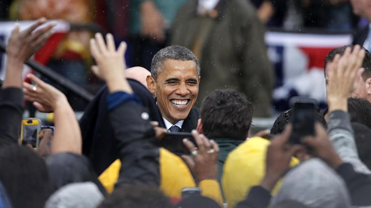 President Barack Obama shakes hands with supporters after speaking at a campaign event at Cleveland State University, Friday, Oct. 5, 2012, in Cleveland. (AP Photo/Tony Dejak)