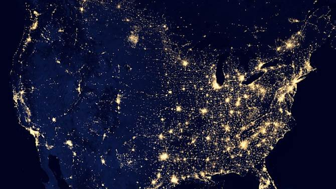 """In this image provided by NASA, the United States of America is seen at night from a composite assembled from data acquired by the Suomi NPP satellite in April and October 2012. The image was made possible by the new satellite's """"day-night band"""" of the Visible Infrared Imaging Radiometer Suite (VIIRS), which detects light in a range of wavelengths from green to near-infrared and uses filtering techniques to observe dim signals such as city lights, gas flares, auroras, wildfires, and reflected moonlight. (AP Photo/NASA)"""