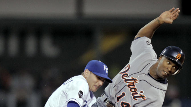 Detroit Tigers' Austin Jackson (14) beats the tag by Kansas City Royals second baseman Johnny Giavotella to steal second during the first inning of a baseball game on Wednesday, Sept. 21, 2011, in Kansas City, Mo. (AP Photo/Charlie Riedel)
