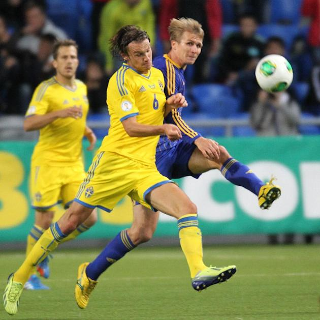 Kazakhstan's Valerij Korobkin, right, and Sweden's Albin Ekdal fight for the ball during their World Cup group C qualifying soccer match in Astana, Kazakhstan, Tuesday, Sept. 10, 2013. (AP Photo)