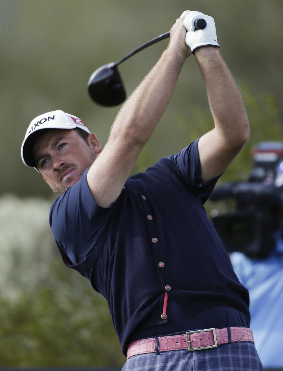 Graeme McDowell, of Northern Ireland, tees off the 17th hole in the second round against Alexander Noren, of Sweden, during the Match Play Championship golf tournament, Friday, Feb. 22, 2013, in Marana, Ariz. McDowell won 1 up in 20 holes. (AP Photo/Ted S. Warren)