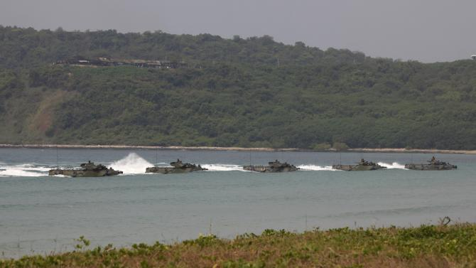 """Thai Marines in their amphibious assault vehicles (AAV) participate in an exercise as part of the """"Cobra Gold 2013"""" (CG13) joint military exercise at a military base in Chonburi province"""