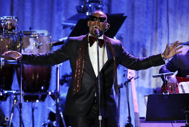 FILE - In this Feb. 12, 2011, file photo, R. Kelly performs in Beverly Hills, Calif. Kelly announced on Monday, Nov. 19, 2012, that he&#39;s had an offer to bring Trapped in the Closet to the stage, and he may even be in some performances. (AP Photo/Mark J. Terrill, File)