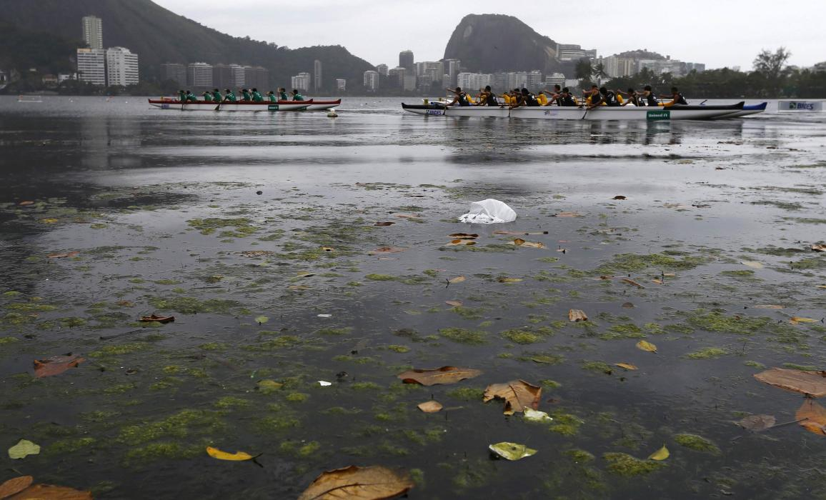 Athletes paddle during a canoeing competition at Rodrigo de Freitas Lagoon in Rio de Janeiro