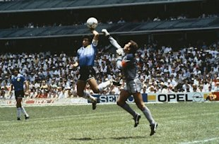 Argentina's Diego Maradona scores 1st goal with his 'Hand of God', past England goalkeeper Peter Shilton.