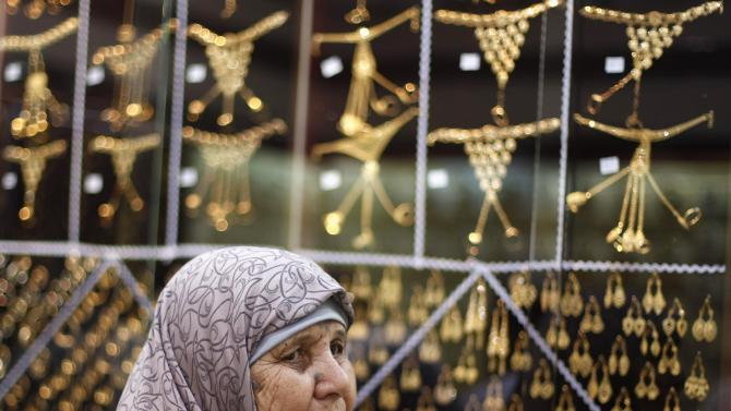 A Muslim pilgrim shops at a jewelry store ahead of the annual haj pilgrimage, in the holy city of Mecca