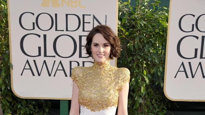 Actress Michelle Dockery arrives at the 70th Annual Golden Globe Awards at the Beverly Hilton Hotel on Sunday Jan. 13, 2013, in Beverly Hills, Calif. (Photo by John Shearer/Invision/AP)