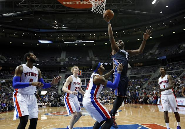 Charlotte Bobcats' Al Jefferson (25) shoots against Detroit Pistons' Josh Smith during the second half of an NBA basketball game in Auburn Hills, Mich., Friday, Dec. 20, 2013. The Bobcats won