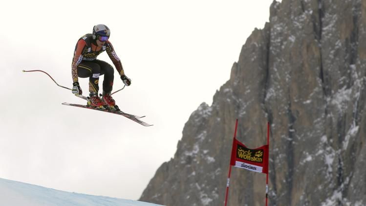 Canada's Guay clears a gate during the second training session of the Men's World Cup Downhill skiing race in Val Gardena