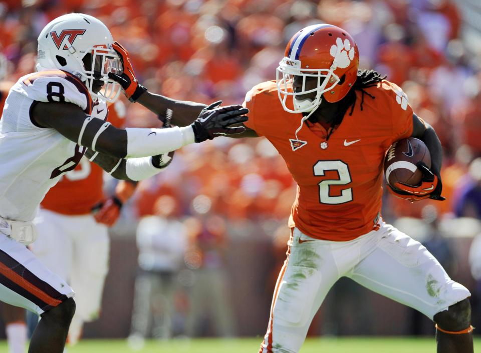 Clemson's Sammy Watkins (2) stiff-arms Virginia Tech's Detrick Bonner (8) during the second half of an NCAA college football game on Saturday, Oct. 20, 2012, in Clemson, S.C. (AP Photo/Rainier Ehrhardt)