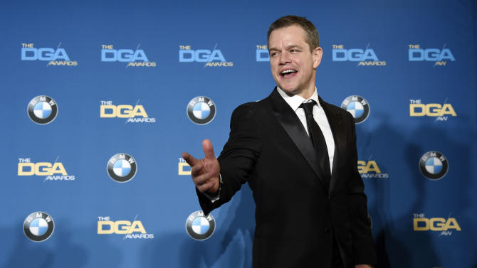 Actor Matt Damon reacts to photographers backstage at the 68th Directors Guild of America Awards at the Hyatt Regency Century Plaza on Saturday, Feb. 6, 2016 in Los Angeles. (Photo by Chris Pizzello/Invision/AP)