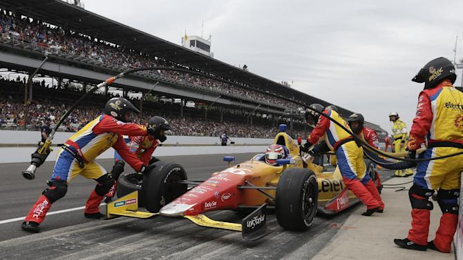 Carlos Munoz, of Colombia, gets service on his car during a pit stop during the Indianapolis 500 auto race at the Indianapolis Motor Speedway in Indianapolis, Sunday, May 26, 2013. (AP Photo/Darron Cummings)