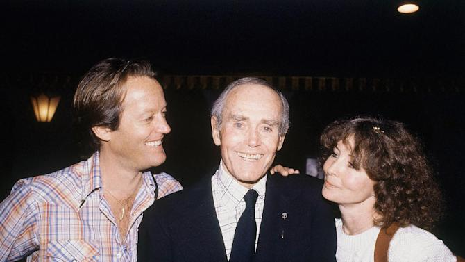 """FILE - In this May 16, 1980 file photo, Henry Fonda, center, is seen on his 75th birthday with son, Peter Fonda, left, and his wife, Shirlee Fonda.  On on Saturday, April 27, 2013, Jane Fonda, the 75-year-old Oscar winner , will place her hand and footprints next to her father's in the concrete shrine to celebrity outside Hollywood's TCL Chinese Theatre. Then she'll present a special screening of the film she made with her dad, """"On Golden Pond."""" The cement and cinematic tribute is part of the 2013 TCM Classic Film Festival, which is honoring Jane Fonda.(AP Photo/Randy Rasmussen, file)"""