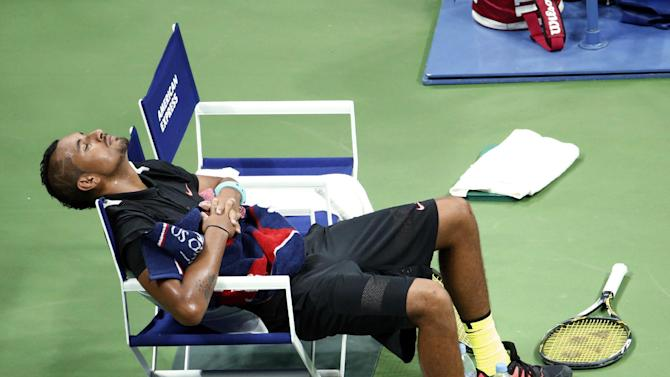Nick Kyrgios, of Australia, rests on his chair before the third set against Andy Murray, of Britain, during the first round of the U.S. Open tennis tournament in New York, Tuesday, Sept. 1, 2015. (AP Photo/Julio Cortez)