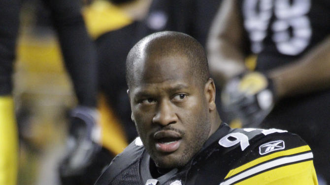 "FILE - Pittsburgh Steelers linebacker James Harrison (92) warms up before an NFL football game against the Carolina Panthers in Pittsburgh, in this Dec. 23, 2010 file photo. Heavily fined Pittsburgh Steelers linebacker James Harrison calls NFL Commissioner Roger Goodell a ""crook"" and a ""devil,"" among other insults, in a magazine article in the August issue of Men's Journal. (AP Photo/Gene J. Puskar, File)"