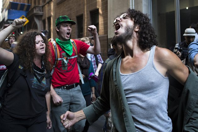 Occupy Wall Street protestors chant during a march in the Financial District, Monday, Sept. 17, 2012, in New York. Multiple Occupy Wall Street protestors have been arrested during a march toward the N
