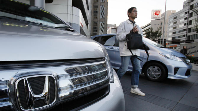 Honda profit jumps, lowers forecasts on China woes