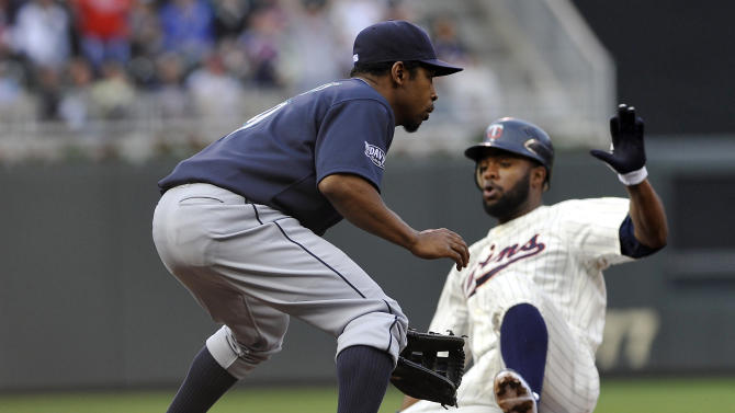 Minnesota Twins' Denard Span slides safely into third on a triple as Seattle Mariners third baseman Chone Figgins waits for the throw in the first inning Tuesday, May 24, 2011 in Minneapolis. (AP Photo/Jim Mone)