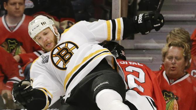 Bruins beat Blackhawks 2-1 in OT, even Cup series