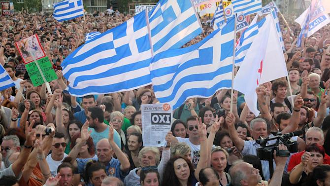 People attend a rally organized by supporters of the No vote in Athens, Friday, July 3, 2015. A new opinion poll shows a dead heat in Greece's referendum campaign with just two days to go before Sunday's vote on whether Greeks should accept more austerity in return for bailout loans. (AP Photo/Spyros Tsakiris)