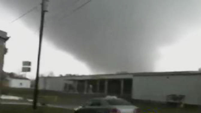 In this image made from video and released by WSB TV in Atlanta, a tornado moves through the town of Adairsville, Ga. on Wednesday, Jan 30, 2013. A fire chief says a storm that roared across northwest Georgia has left overturned vehicles on Interstate 75 northwest of Atlanta, and crews are responding to reports of people trapped in storm-damaged residential and commercial buildings. (AP Photo/WSB TV) MANDATORY CREDIT