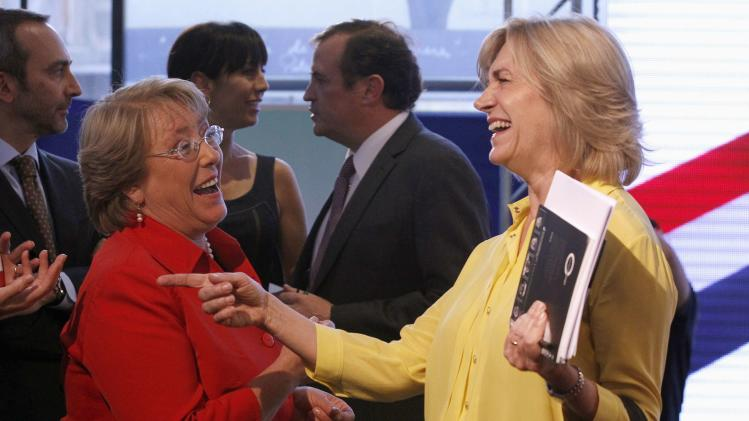 Chilean presidential candidates Bachelet of Nueva Mayoria (New Majority) and Matthei of the ruling conservative right-wing bloc, joke after taking part in a live radio debate in Santiago