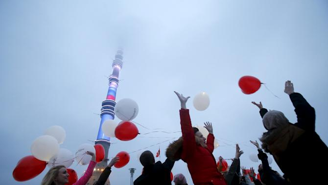 People throw balloons ahead of Valentine's Day near Ostankino television tower in Moscow