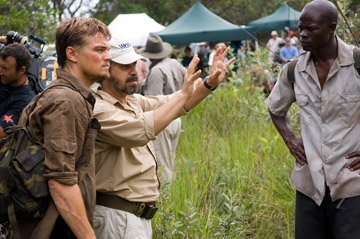 Leonardo DiCaprio director Edward Zwick and Djimon Hounsou on the set of Warner Bros. Blood Diamond