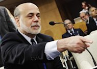 U.S. Federal Reserve Chairman Ben Bernanke gestures at the International Monetary and Financial Committee (IMFC) meeting during the Spring Meeting of the IMF and World Bank in Washington, April 20, 2013. REUTERS/Yuri Gripas