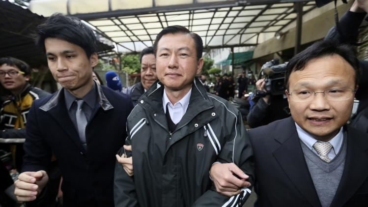 Former commander Shen Wei-chih walks out of a courthouse after a verdict hearing in Taoyuan