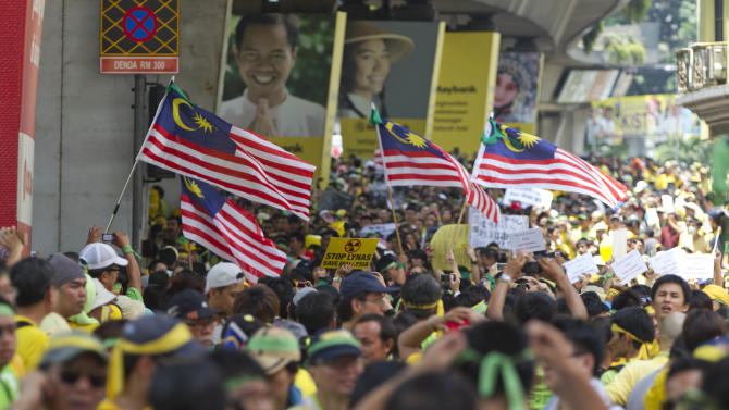 Malaysian flags fly as thousands of protesters line the streets in Kuala Lumpur, Malaysia, Saturday, April 28, 2012. Thousands of people gathered near Kuala Lumpur's Independence Square to seek sweeping changes in polling regulations to curb fears of fraud in elections that many speculate will be held in June. (AP Photo/Mark Baker)
