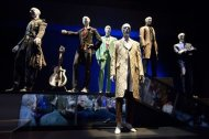 "A variety of stage costumes worn by musician David Bowie are seen at the ""David Bowie is"" Exhibition at the Victoria and Albert Museum in London March 20, 2013. REUTERS/Neil Hall"