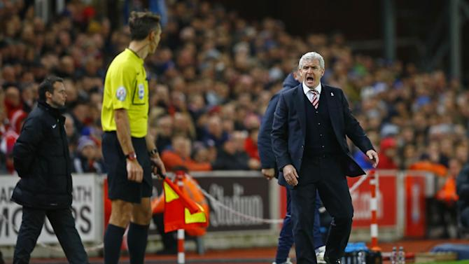 Stoke manager Mark Hughes remonstrates with the assistant referee