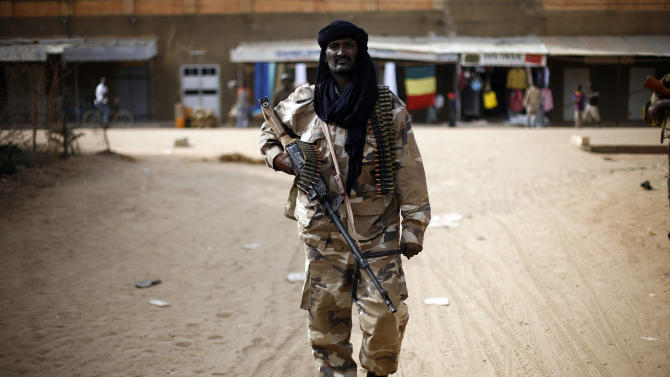 "Chadian troops patrol the streets of  Gao, northern Mali, Tuesday Jan. 29, 2013, days after Malian and French military forces closed in and retook the town from Islamist rebels. Earlier Tuesday, four suspected extremists were arrested after being found by a youth militia calling themselves the ""Gao Patrolmen"".  (AP Photo/Jerome Delay)"
