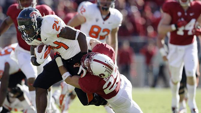 Oregon State running back Storm Woods (24) runs against Stanford cornerback Alex Carter (25) during the second quarter of an NCAA college football game in Stanford, Calif., Saturday, Nov. 10, 2012. (AP Photo/Jeff Chiu)