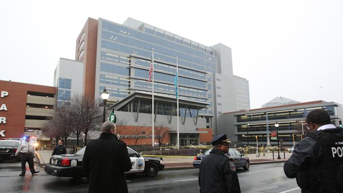 Police stand outside the New Castle County Courthouse, Monday morning, Feb. 11, 2013 in WIlmington, Del. , after a man killed his estranged wife and two others at teh courthouse.  The mayofro f Wilmington says police have killed the gunman.  (AP Photo/The News Journal/William Bretzger)  PHILADELPHIA TV OUT AND PHILADELPHIA ONLINE SITES OUT