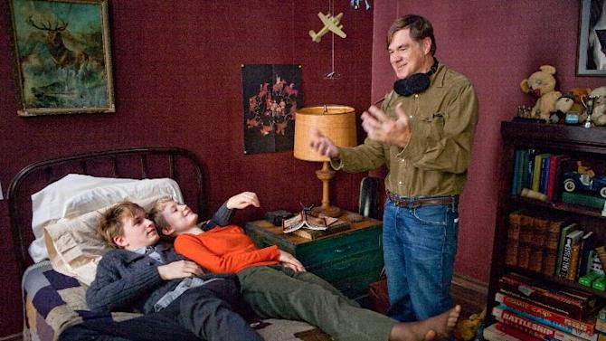 """In this film image released by Sony Pictures Classics, Henry Hopper, left, and Mia Wasikowska, listen to director Gus Van Sant on the set of """"Restless."""" Van Sant also directed the popular films """"Good Will Hunting,"""" """"To Die For,"""" """"Milk,"""" """"My Own Private Idaho"""" and """"Drugstore Cowboy."""" (AP Photo/Sony Pictures Classics, Scott Green)"""