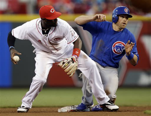 Izturis' hit in 13th sends Reds past Cubs 5-4