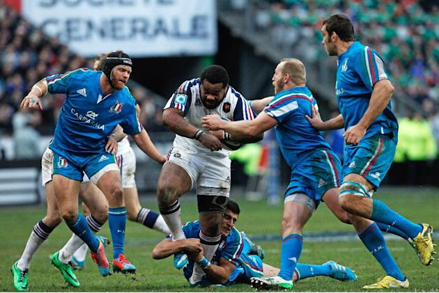France's Mathieu Bastareaud, center, runs with the ball, during his Six Nations rugby union international match against Italy, at the Stade de France, in Saint Denis, outside Paris, Sunday, Feb 9,