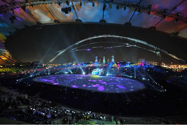 The Sheikh Khalifa stadium is colourfully lit during the opening ceremony of the pan-Arab Games at in the Qatari capital Doha on December 9, 2011. More than 5,000 Arab athletes are participating in th